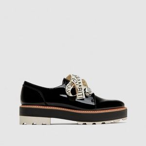 ZARA FAUX PATENT BROGUES WITH SLOGAN PRINT BOW